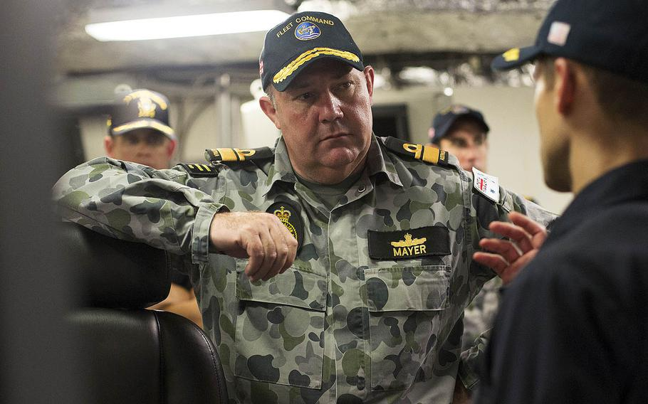 Australian Rear Adm. Stuart Mayer visits the USS Independence during the Rim of the Pacific exercise in 2014.