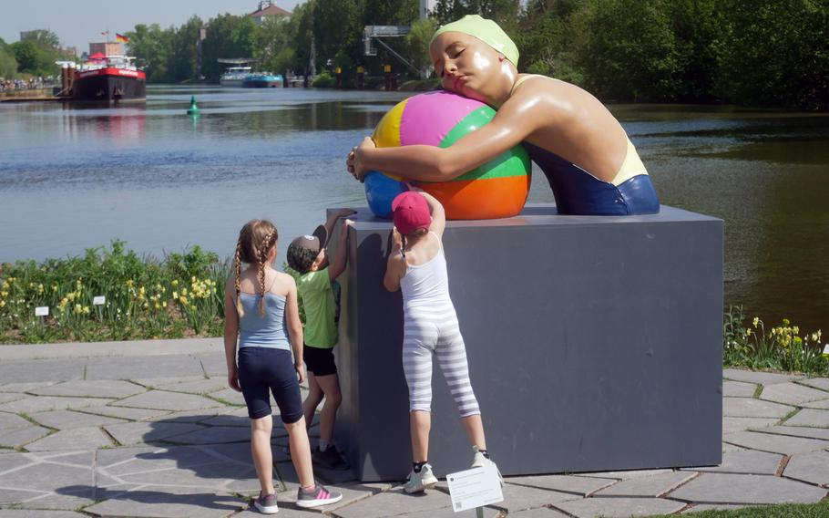 A trio of children check out Monumental Brooke with Beach Ball at the Bundesgartenschau in Heilbronn, Germany. There are a number of art works to be seen among the flowers and plants at the federal garden show that lasts until Oct. 6.