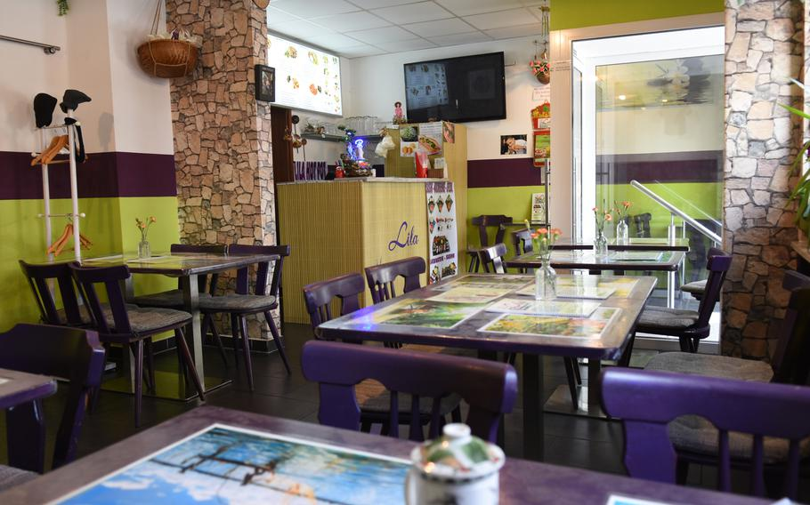 The inside of Lila South Vietnamese Specialties, a restaurant in downtown Kaiserslautern, Germany, is small but cheerful and clean, with freshly-cut flowers and Asian decor brightening the cozy dining room.