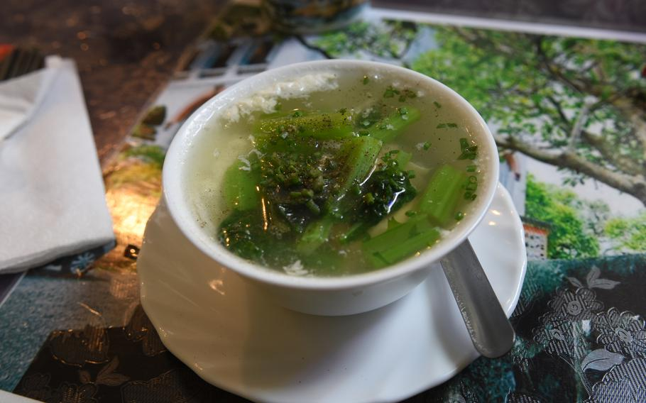 The Vietnamese mustard green soup -- canh cai be xanh -- at Lila South Vietnamese Specialties, a restaurant in Kaiserslautern, Germany, specializing in southern Vietnamese cuisine, was fresh tasting. The crisp greens hide a cooked egg.