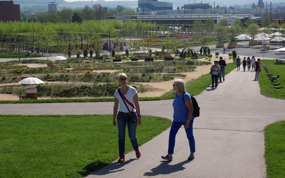 Visitors walk through the vast grounds of the Bundesgartenschau in Heilbronn, Germany. It is built on what was once a freight depot and switching yard.