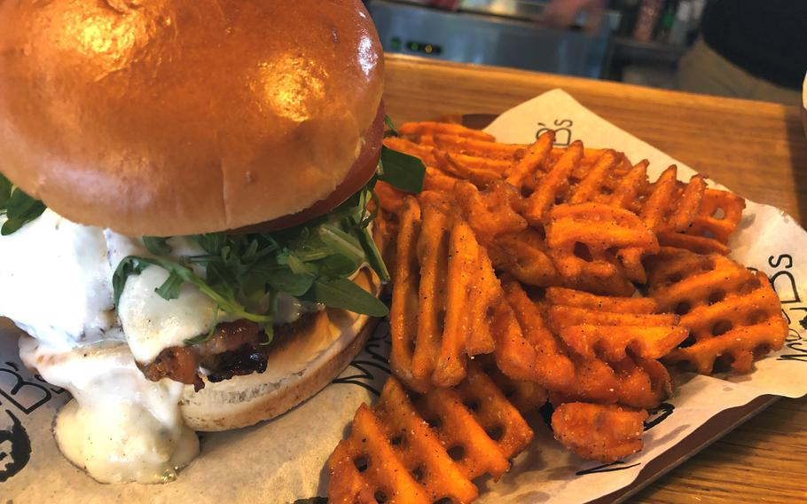 Mr. B's Greek burger mixes the flavors of a freshly cooked burger and the tastes of a gyro, perfectly balanced with feta cheese, tzatziki sauce and bacon. Slightly messy, doubly delicious.