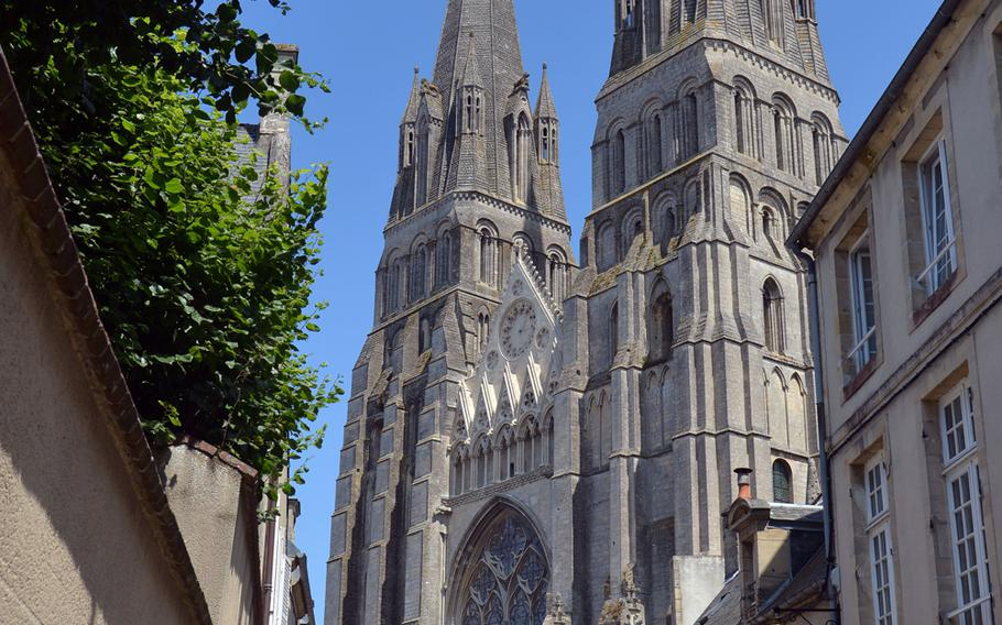 Notre Dame, Bayeux, France's 13th-century Gothic cathedral rises up over the streets of the city. Its crypt dates to the 11th century, but the copper dome is from the 19th century.
