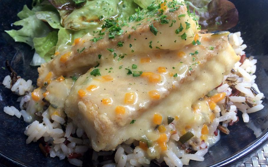 Bayeux, along with the rest of Normandy, is a great place to try French cuisine, especially fish and seafood. At l'Alchimie on Rue Saint Jean they served this pollock served in an orange sauce on rice.