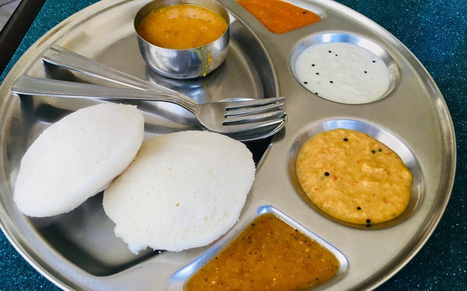 An Indian breakfast favorite called idli, a savory rice pastry served with curry, at Saravana Bhavan in Bahrain. Saravana Bhavan is an international chain serving southern Indian vegetarian cuisine.