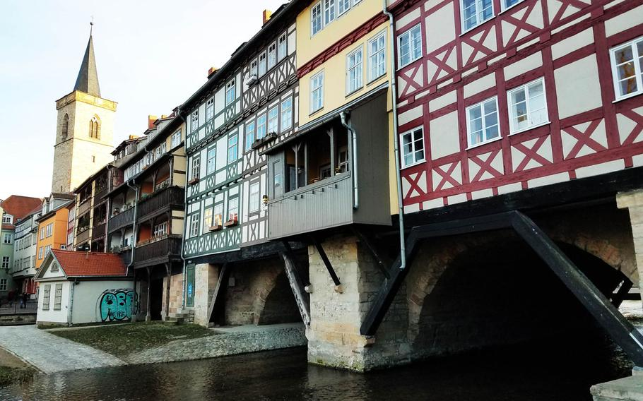 The Merchant's Bridge in Erfurt lined with houses and shops. The bridge is one of the last inhabited bridges left in the world.
