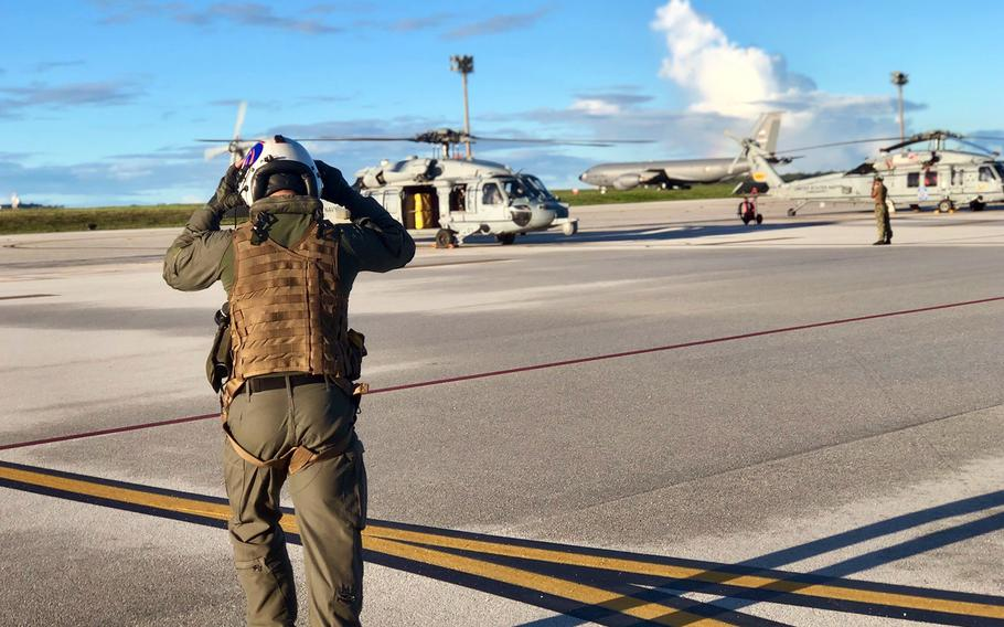 A helicopter pilot walks the runway at Andersen Air Force Base, Guam, during the inaugural Pacific Vanguard exercise, Friday, May 24, 2019.