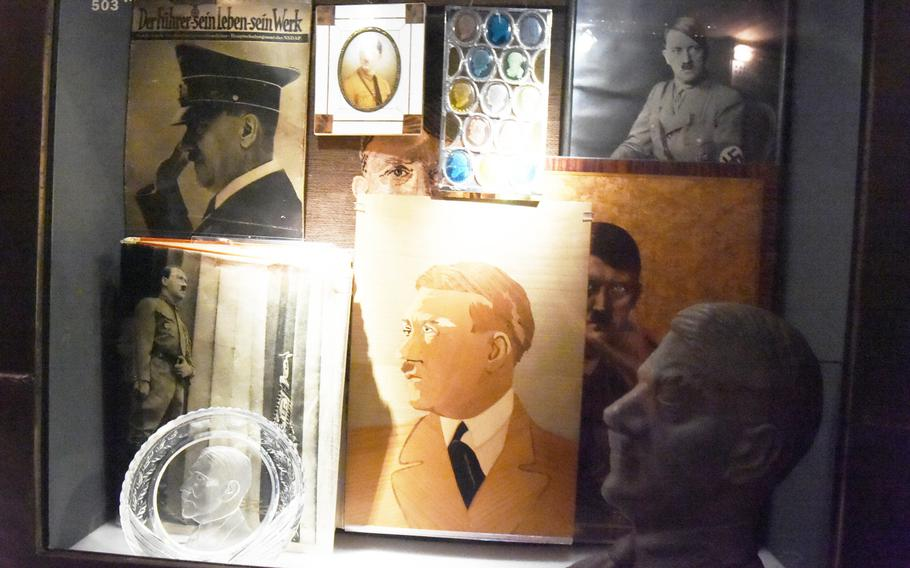 """An exhibit inside the museum of the Documentation Center Nazi Party Rallying Grounds, showcasing the """"Cult of Hitler"""" in Nuremberg, Germany."""