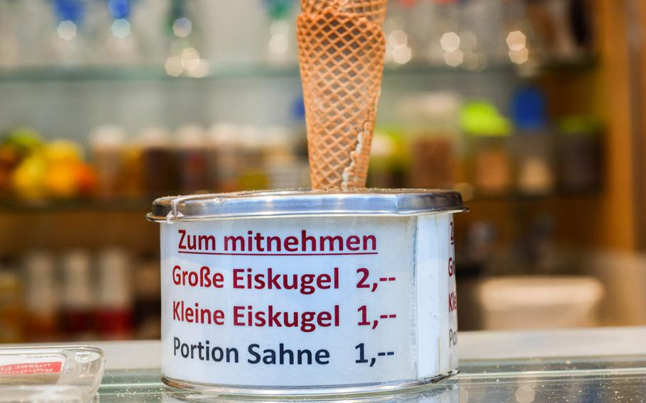 A stack of ice cream cones stand atop a can showing the prices of ice cream to go at Palazzo Sandro in Kaiserslautern, Germany, on July 22. Most ice cream shops and cafes in Kaiserslautern sell a single scoop for 1 euro, although some priced a one-scoop cone or cup at 1.20 euros.