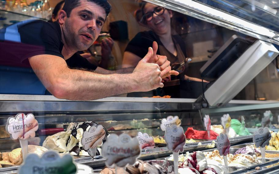 Daniel Moraes gives the thumbs-up through the glass freezer display at the San Marco Eiscafe in Kaiserslautern, Germany, on July 22.  San Marco's 35 flavors of ice cream are home-made above the cafe.