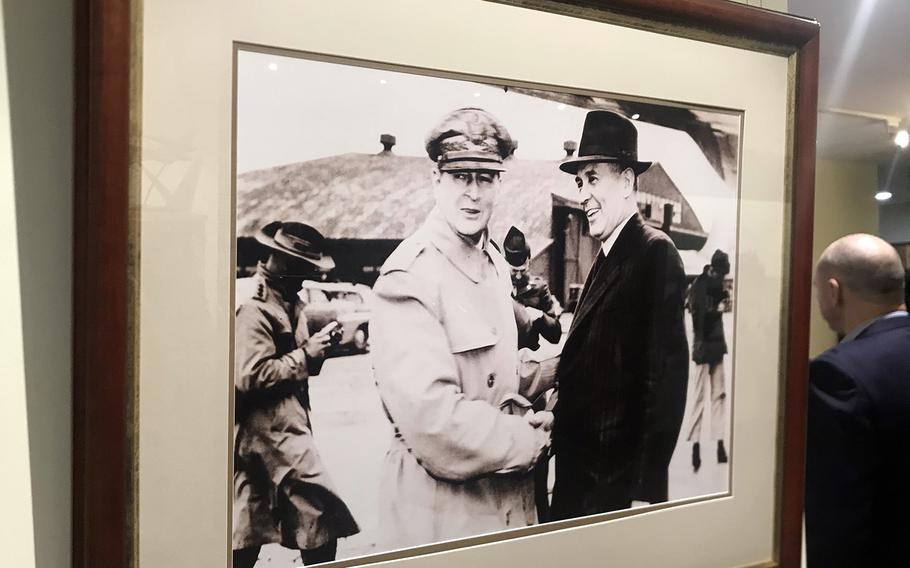 A photograph at the MacArthur Museum Brisbane shows Gen. Douglas MacArthur meeting Australian Prime Minister Ben Chifley at Atsugi Airfield, Japan, May 13, 1946.