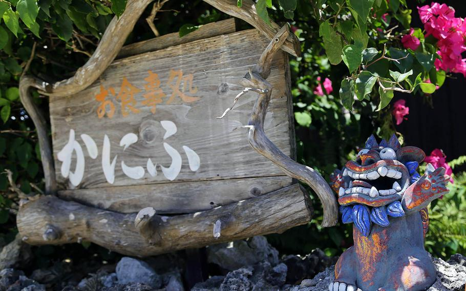 Aged and distressed stone walls, red-tile roofs, shisa and bougainvillea are typical of traditonal Ryukyu-style houses on Taketomi Island.