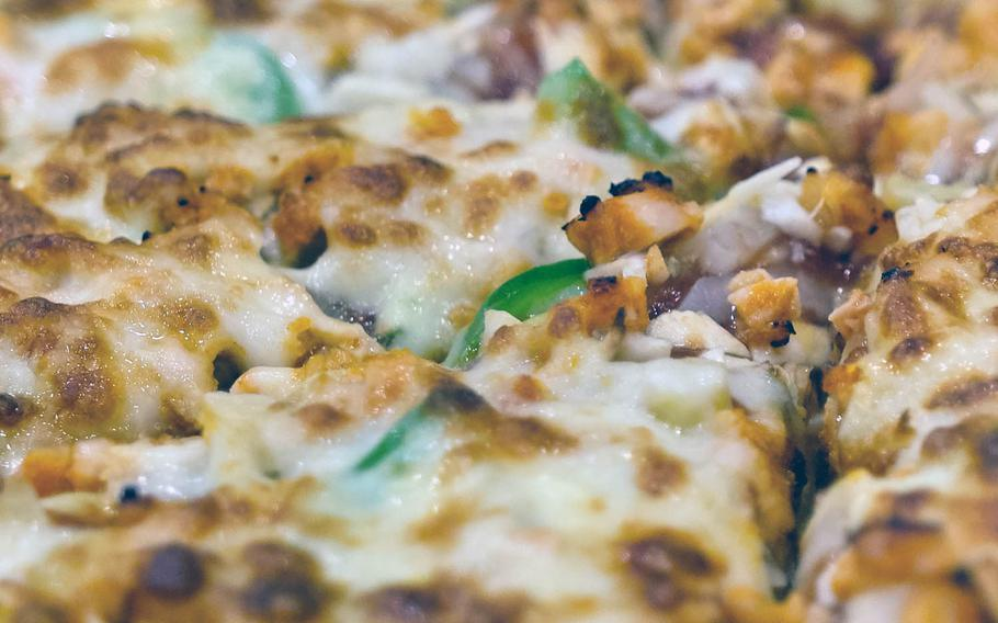The hot chicken pizza resembles the taste of spicy chicken wings at Pizza School near Osan Air Base in Songtan, South Korea.