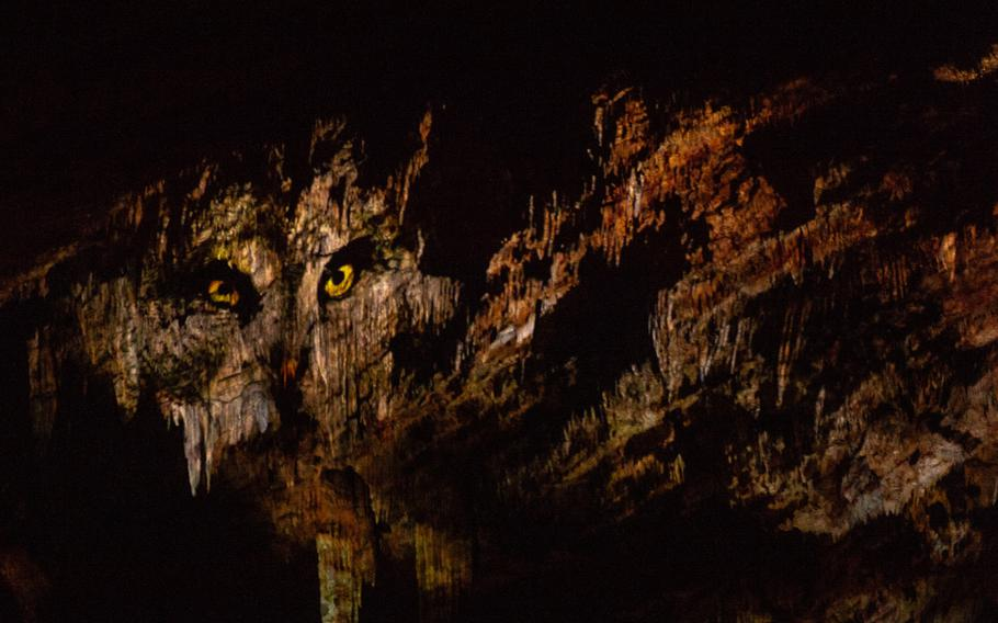 The face of an owl projected on the cave wall during a sound and light show in the weapons room in the Domain of the Caves of Han, Han-sur-Lesse, Belgium, Aug. 17, 2019.
