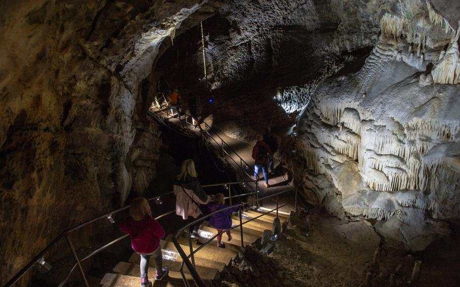 Visitors descend stairs into the cave at the Domain of the Caves of Han, Han-sur-Lesse, Belgium, Aug. 17, 2019.