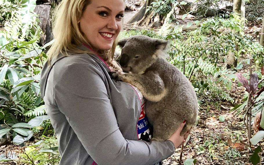 Stars and Stripes reporter Caitlin Doornbos holds a koala named Drew at Lone Pine Koala Sanctuary near Brisbane, Australia, July 7, 2019.