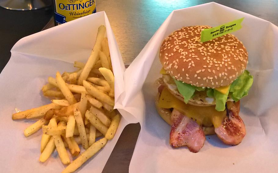 The Deluxe from Sasebo C&B Burgers is packed with bacon and stands nearly 5 inches tall.