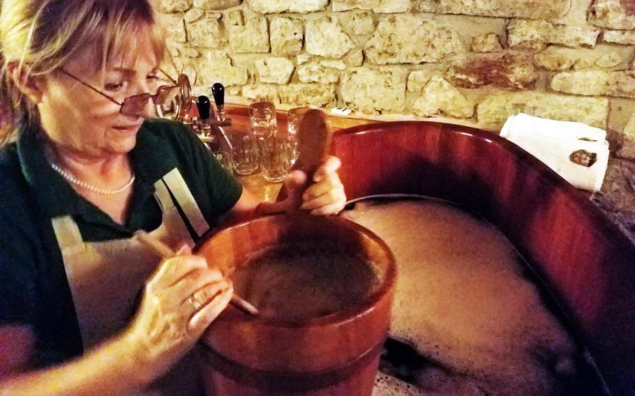 A Spa Beerland Karlovy Vary employee prepares a beer tub for use, in Karlovy Vary, Czech Republic.
