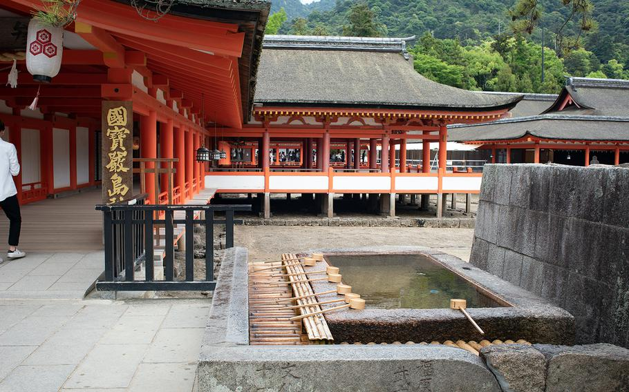 The entrance to Itsukushima Shrine at Miyajima, Japan, is a photographer's dream with its brilliant orange pillars and wooden walkways.