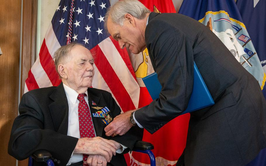 """Secretary of the Navy Richard V. Spencer, right, awards retired aviation machinist mate 1st class Bernard B. Bartusiak, 95, with two Distinguished Flying Cross medals and the Air Medal, at a ceremony at the Pentagon on Tuesday, Sept. 10, 2019. Bartusiak earned the awards for dozens of missions he flew as part of a bomber crew during World War II, but """"for reasons unknown,"""" never received them until three-quarters of a century later."""