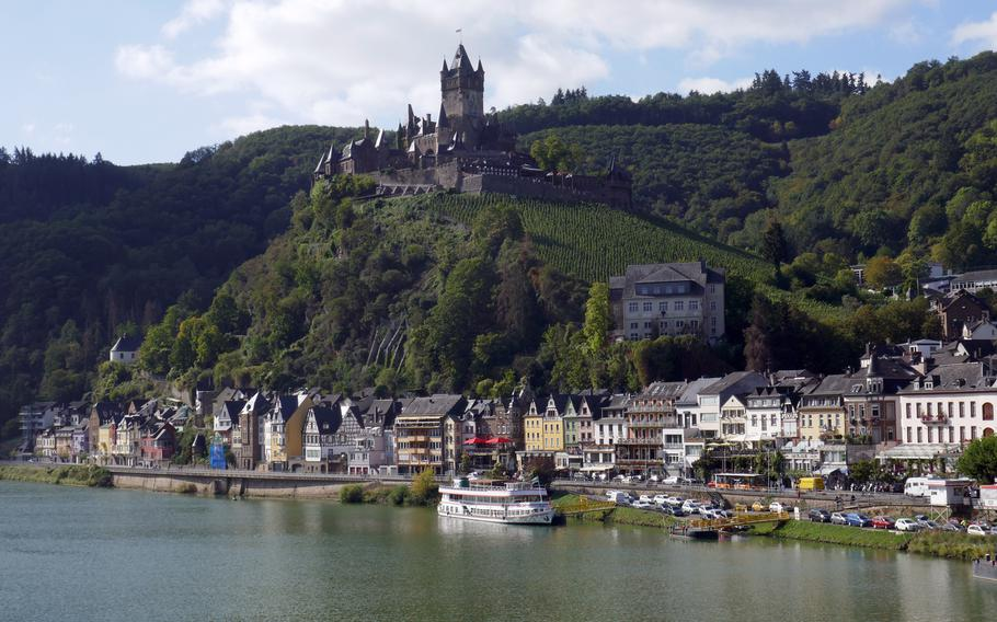 The Reichsburg Cochem towers over the city and the Moselle River. Parts of the castle date back to the 11th century and the town is a popular tourist destination.