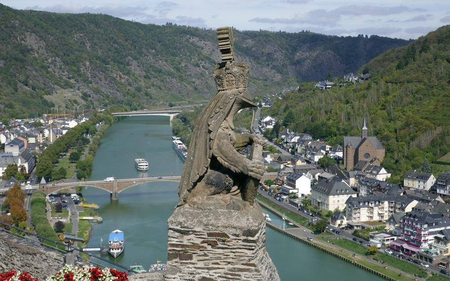 A stone knight looks out from the Reichsburg high over Cochem, Germany, and the Moselle River valley. The castle was first built in the 11th century.