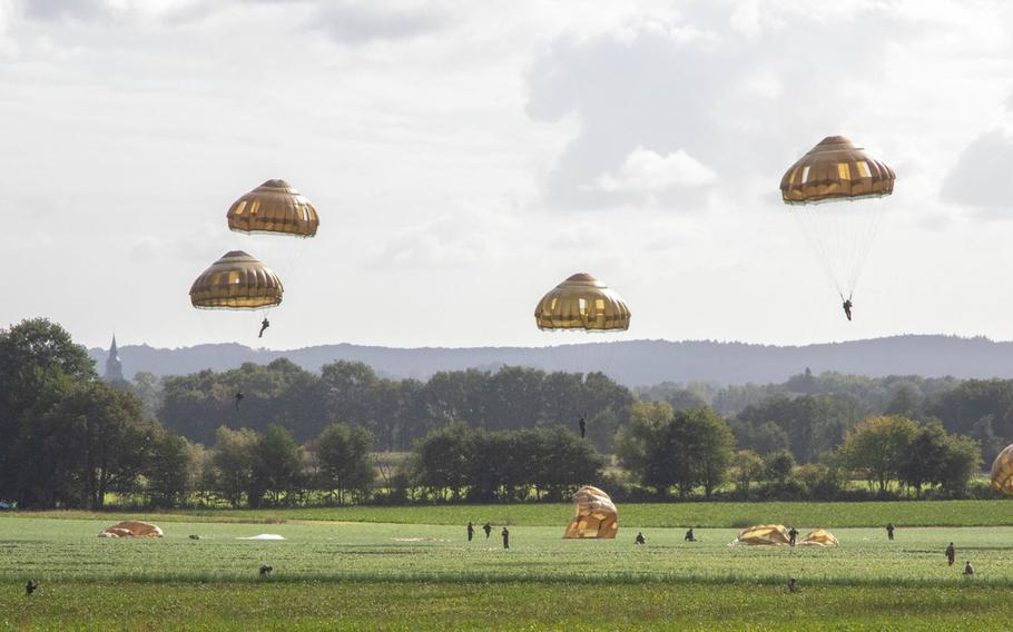 Soldiers of 82nd Airborne Division land after parachuting out of a C-130 Hercules to commemorate the 75th anniversary of Operation Market Garden, and begin the ceremony to present the Military Order of William to WWII veterans in Groesbeek, Netherlands, Sept. 18th, 2019.