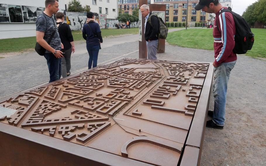Visitors check out where the Wall used to run on a scale model at the Berlin Wall Memorial complex on Bernauer Strasse.