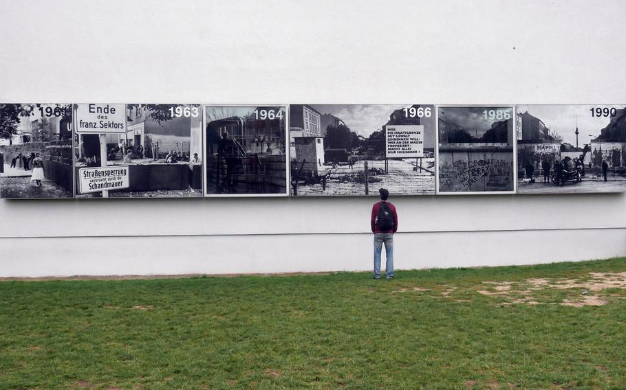 A visitor to the Berlin Wall Memorial Complex on Bernauer Strasse looks at the Wall's history in photos.