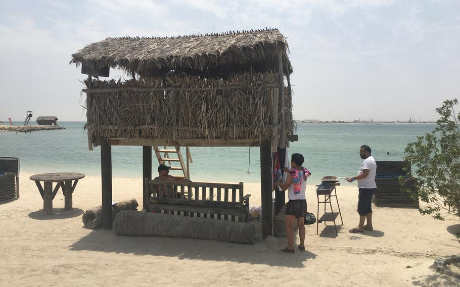 Visitors barbecue and relax in the shade at Al Dar Island.