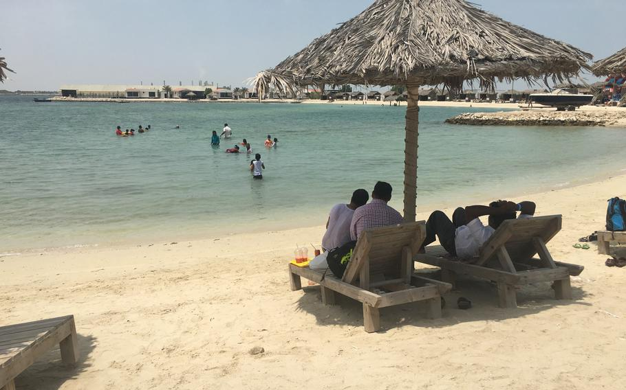 Visitors relax in the shade at Al Dar Island on Aug. 12, 2019.