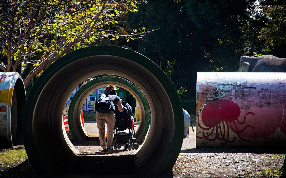 A mother and child explore a play area at Hamura Zoo in western Tokyo, Oct. 9, 2019.   Theron Godbold/ Stars and Stripes