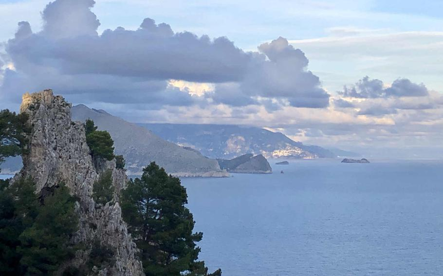 As you approach Arco Naturale on the left, you can see Capri's green, rugged hills jutting into the sea.