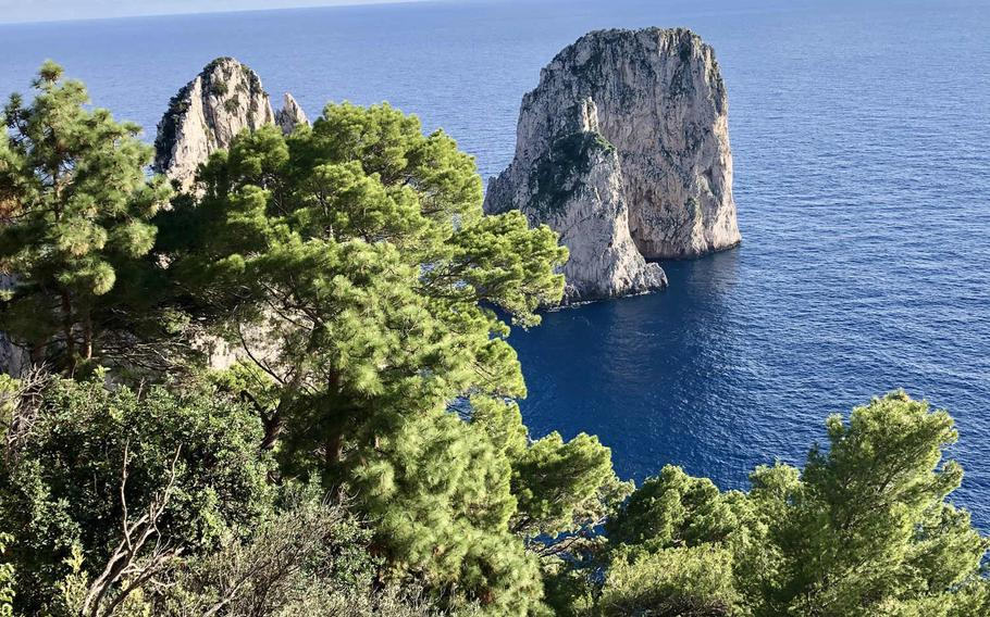 Capri's iconic Faraglioni rocks as seen from Hotel Punta Tragara's scenic overlook.