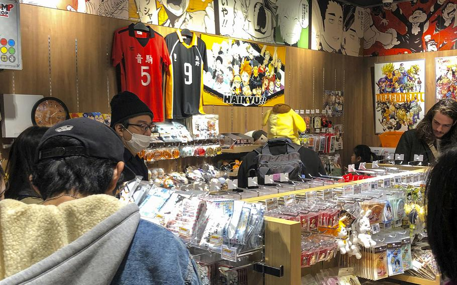 Customers browse anime merchandise at the Jump Shop inside Parco Shibuya in Tokyo, Sunday, Dec. 1, 2019.
