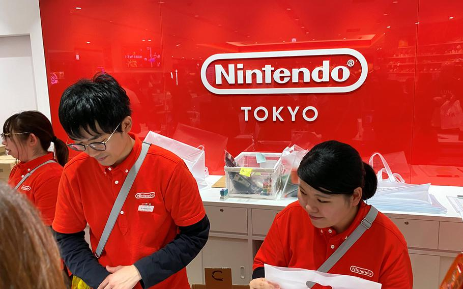 Nintendo Tokyo clerks ring up purchases at the store inside the Parco Shibuya building, Thursday, Nov. 28, 2019.