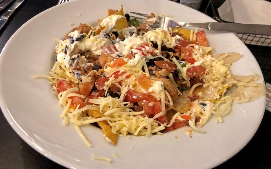 A half-eaten plate of nachos at The Alamo Tex Mex Restaurant and Sports Bar.
