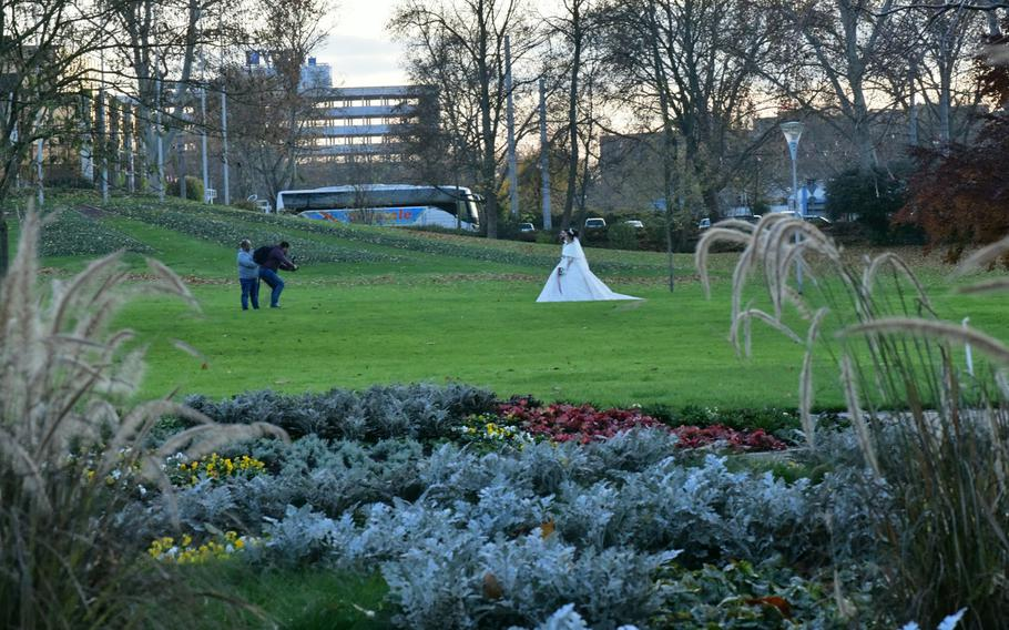 A couple poses for wedding photos in Luisenpark in Mannheim, Germany, on Sunday, Nov. 30, 2019. In addition to hosting weddings, the park is home to a Schnullerbaum - literally a pacifier tree - where children hang their pacifiers when they or their parents think it's time to kick the habit.