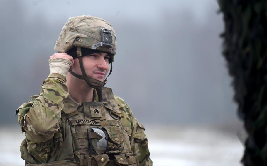 Sgt. Andrew Moreno, a howitzer section chief with Bulldog Battery, 2nd Cavalry Regiment, gets ready to fire rounds during a live-fire exercise in Vilseck, Germany, Dec. 12, 2019.