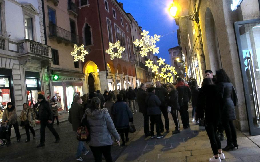 Vicenza's pedestrian friendly old town is lit with lights and shoppers throughout the winter holidays.