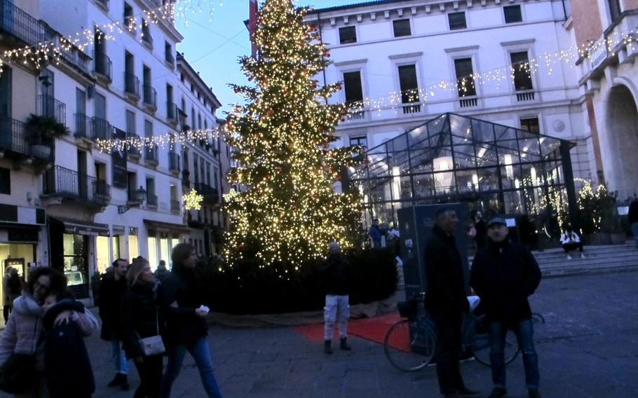 A Christmas tree in the Piazza dei Signori in Vicenza's old town is a popular backdrop for selfies.