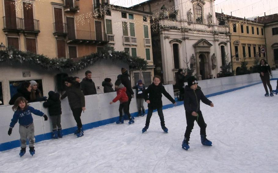 Impervious to cold, able to repeatedly spring up unharmed from hard falls, children skate with glee on Vicenza's downtown ice skating rink.