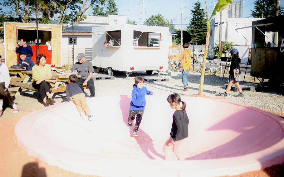 The centerpiece of the Delta East food cart community in Fussa, Japan, is an empty, shallow pool that kids love to play in.