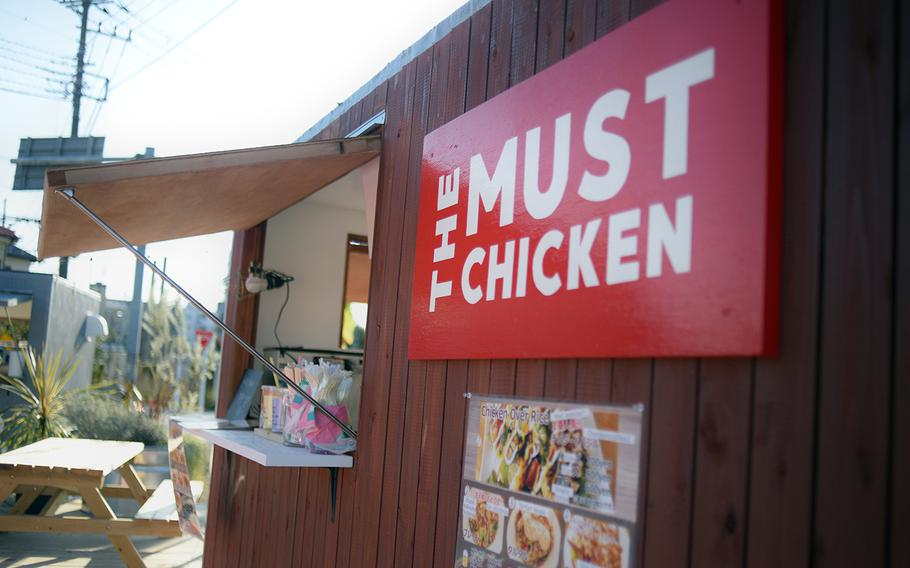 The Must Chicken at Delta East in Fussa, Japan, serves a variety of chicken-over-rice dishes, including the popular cheddar and basil flavor.
