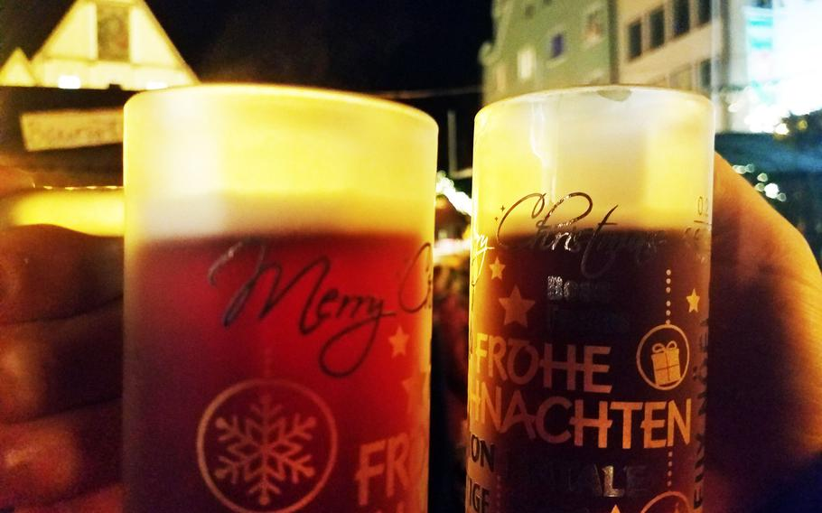 Two types of Gluehwein in festive mugs at the Weiden Christmas Market, Nov. 30, 2019.