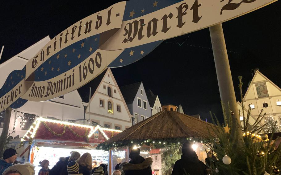 The entrance of a Christkindlmarkt  or Christmas market in Weiden, Germany on November 30, 2019. These markets offer an assortment of goods and mulled wine, called Gluehwein in German.