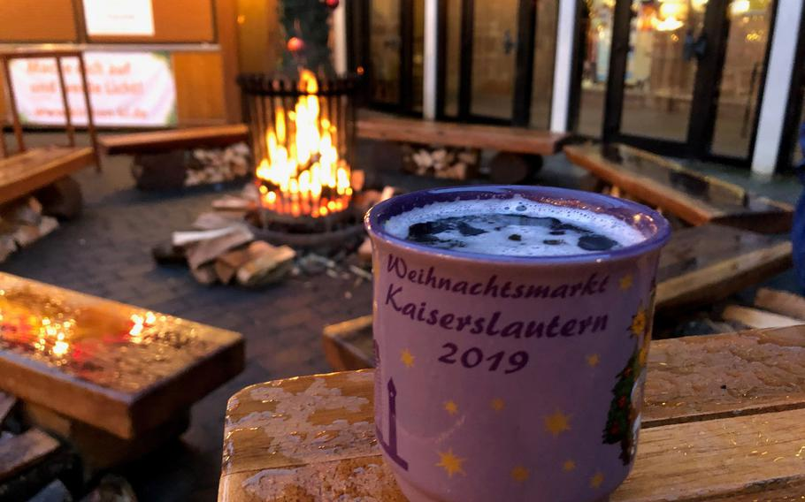 The Gluehwein mugs at the Kaiserslautern Christmas market this year are purple.   Heather Benit/Stars and Stripes