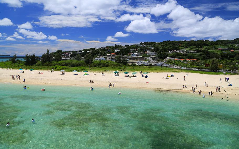 Kouri Beach, a popular swimming spot on Kouri Island, Okinawa, boasts shallow water suitable for families with small children.