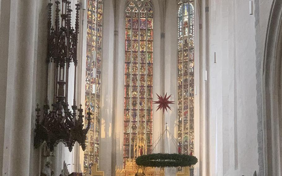 A view of the main altar, depicting the 12 apostles, inside St. James's Church in Rothenburg, Germany. The church was built over a 100-year period during the 14th and 15th centuries.