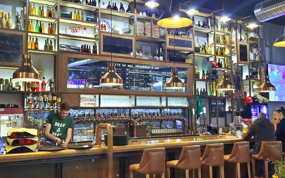 Doppio Malto's bar serves craft beers and a full menu of alcoholic and non-alcoholic beverages. Doppio Malto is a new restaurant and brewery located adjacent to the Granfiume Gran Shopping mall in Fiume Veneto, Italy.